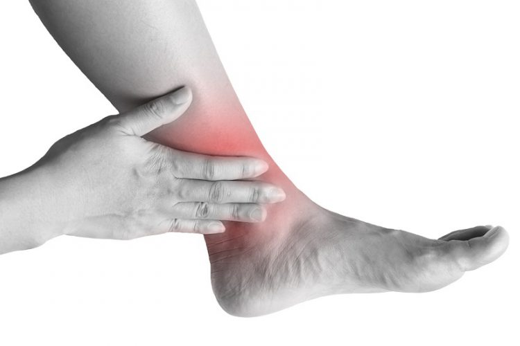 Foot or ankle injury from exercise on white background, Clipping path included.